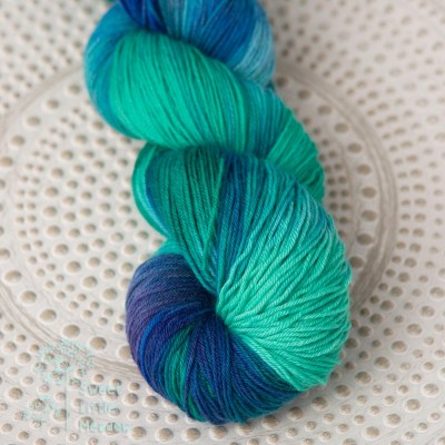 Crisp blue and deep bright greens skein of sock wool merino superwash handdyed indie dyer